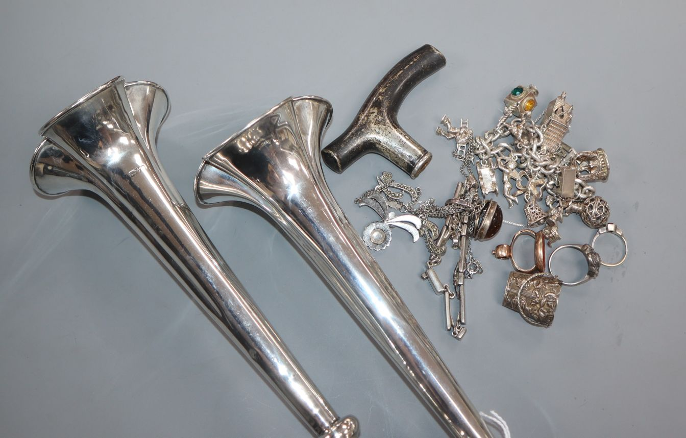 A pair of silver spill vases and a quantity of mixed mainly silver jewellery.
