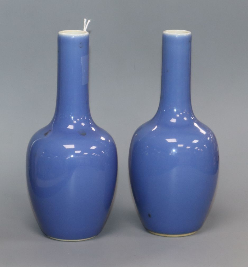 A pair of Chinese blue ground bottle vases