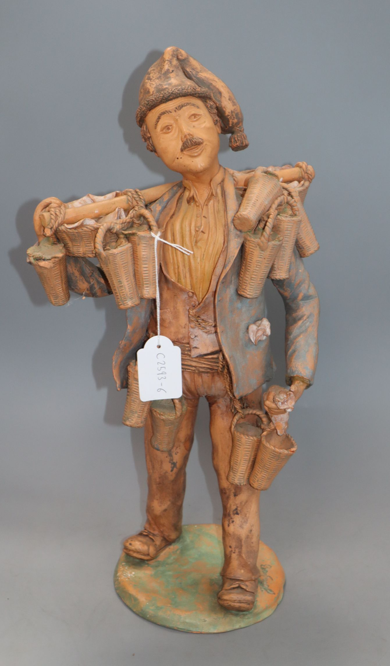 Lot 69 - A signed terracotta figure, 'The strawberry seller', indistinctly signed height 43cm