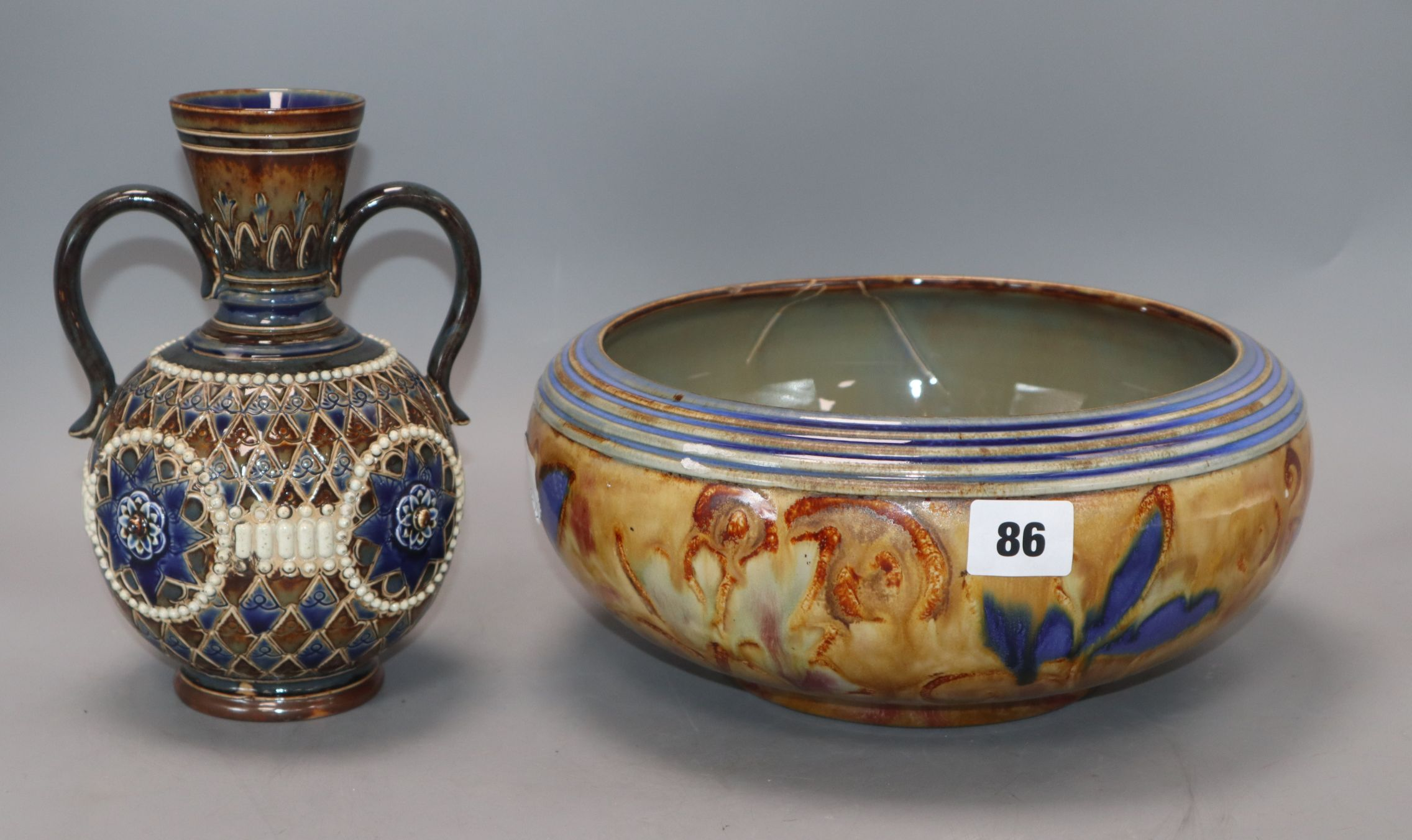 Lot 86 - A Doulton Lambeth two handled vase and a similar bowl