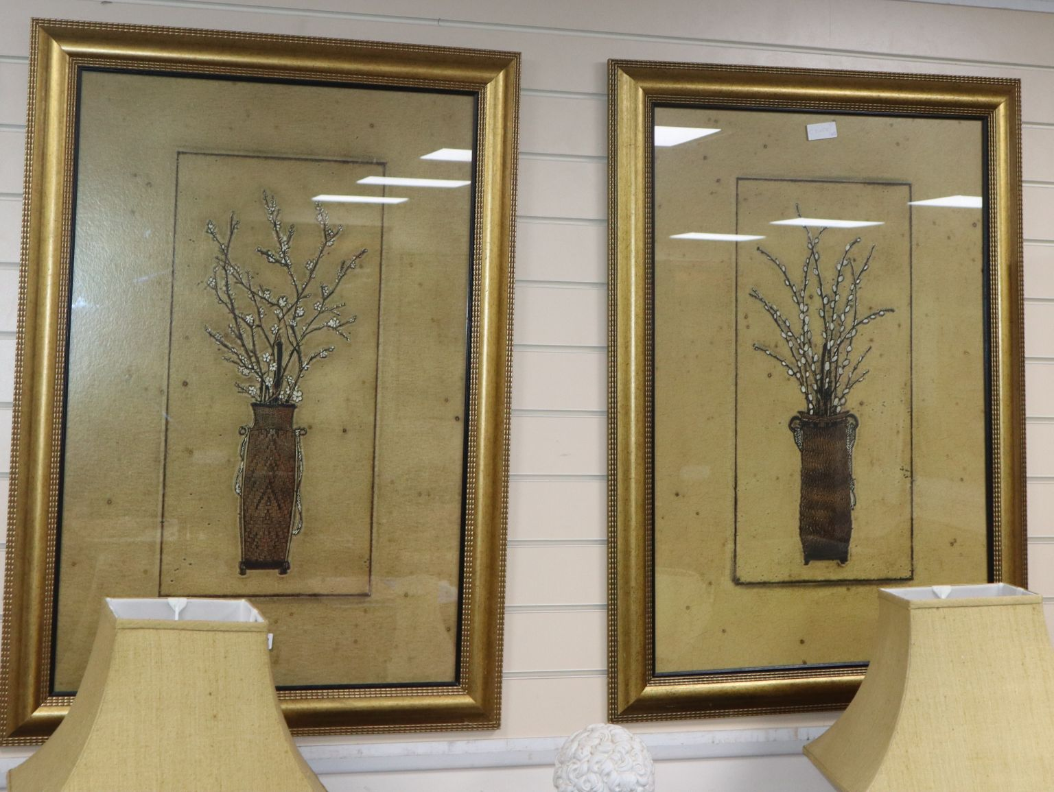 A pair of large coloured prints, blossom sprigs in vases, 88 x 58cm