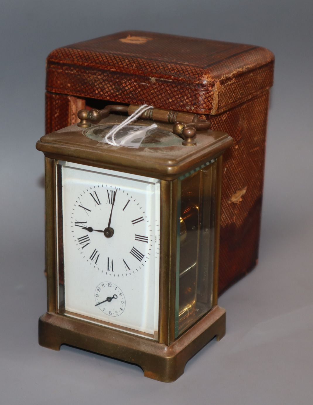 Lot 318 - A cased brass carriage clock