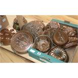 A quantity of copper jelly moulds