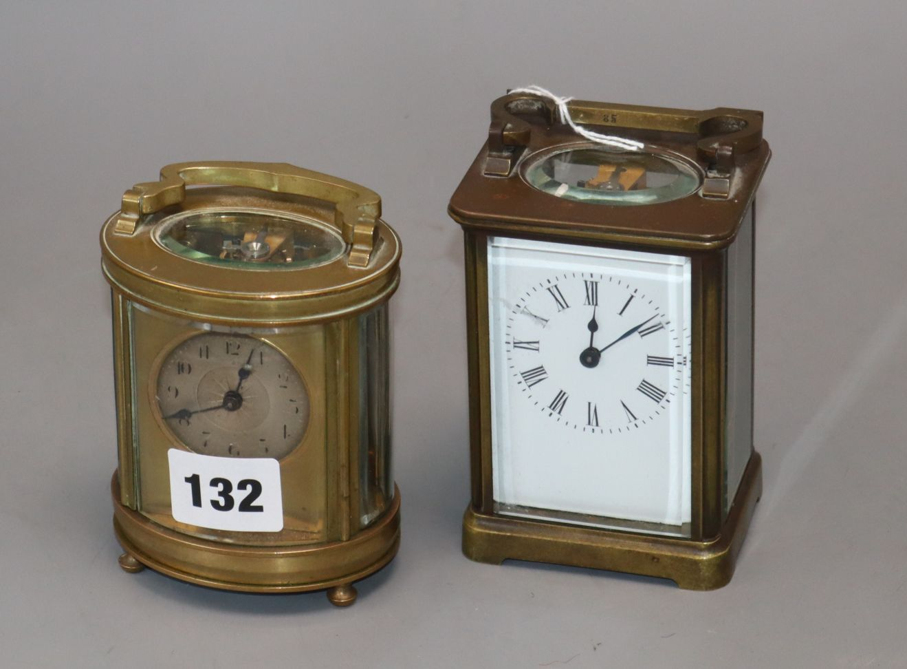 Lot 132 - An oval brass carriage timepiece and one other