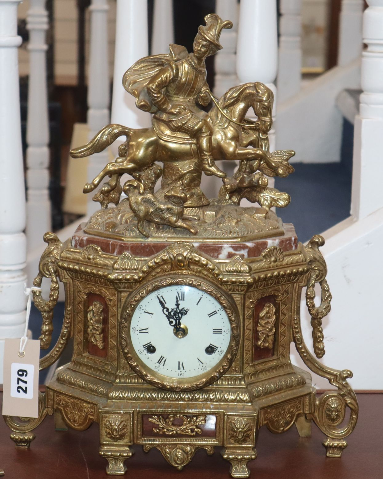 Lot 279 - A French gilt metal and marble mantel clock