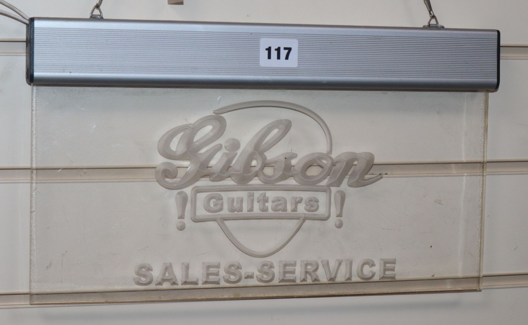 Lot 117 - Gibson guitars, Sales and Service sign