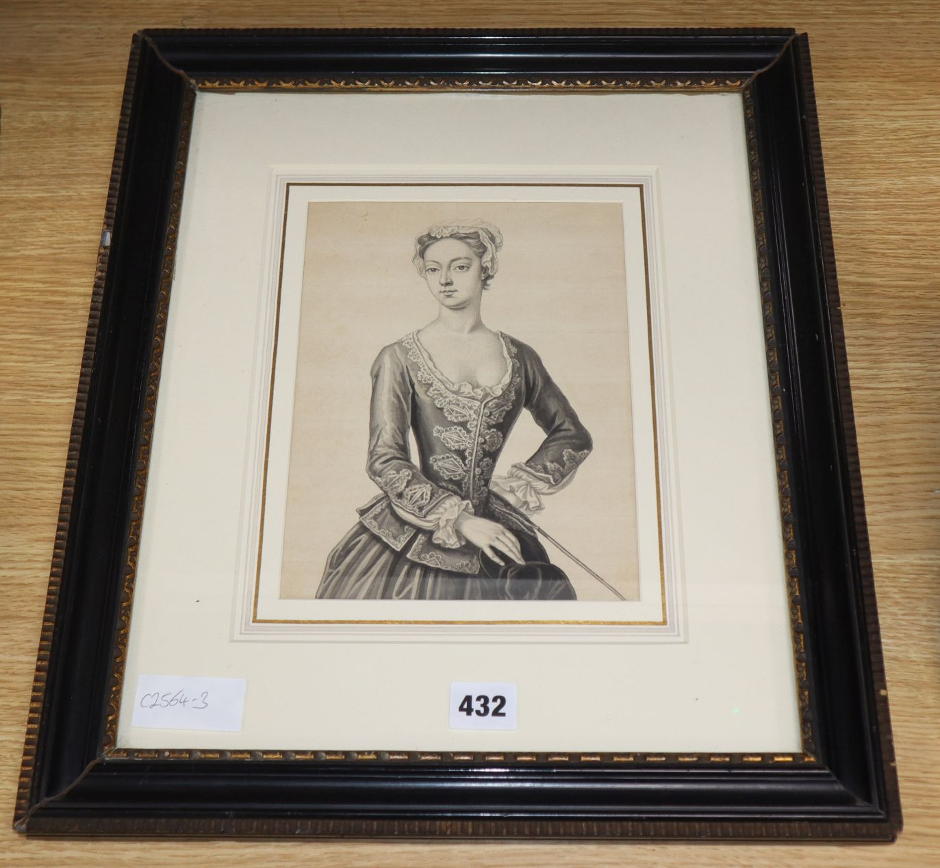 Lot 432 - 18th century English School, ink and wash, half length portrait of a lady, 23 x 17cm.