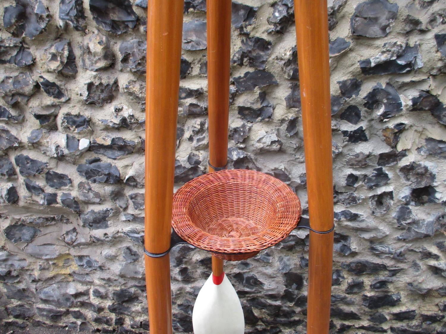 Lot 216 - A tall coat stand in the form of three oars