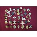 Box containing a large selection (approx 50) various military cap badges including staybright