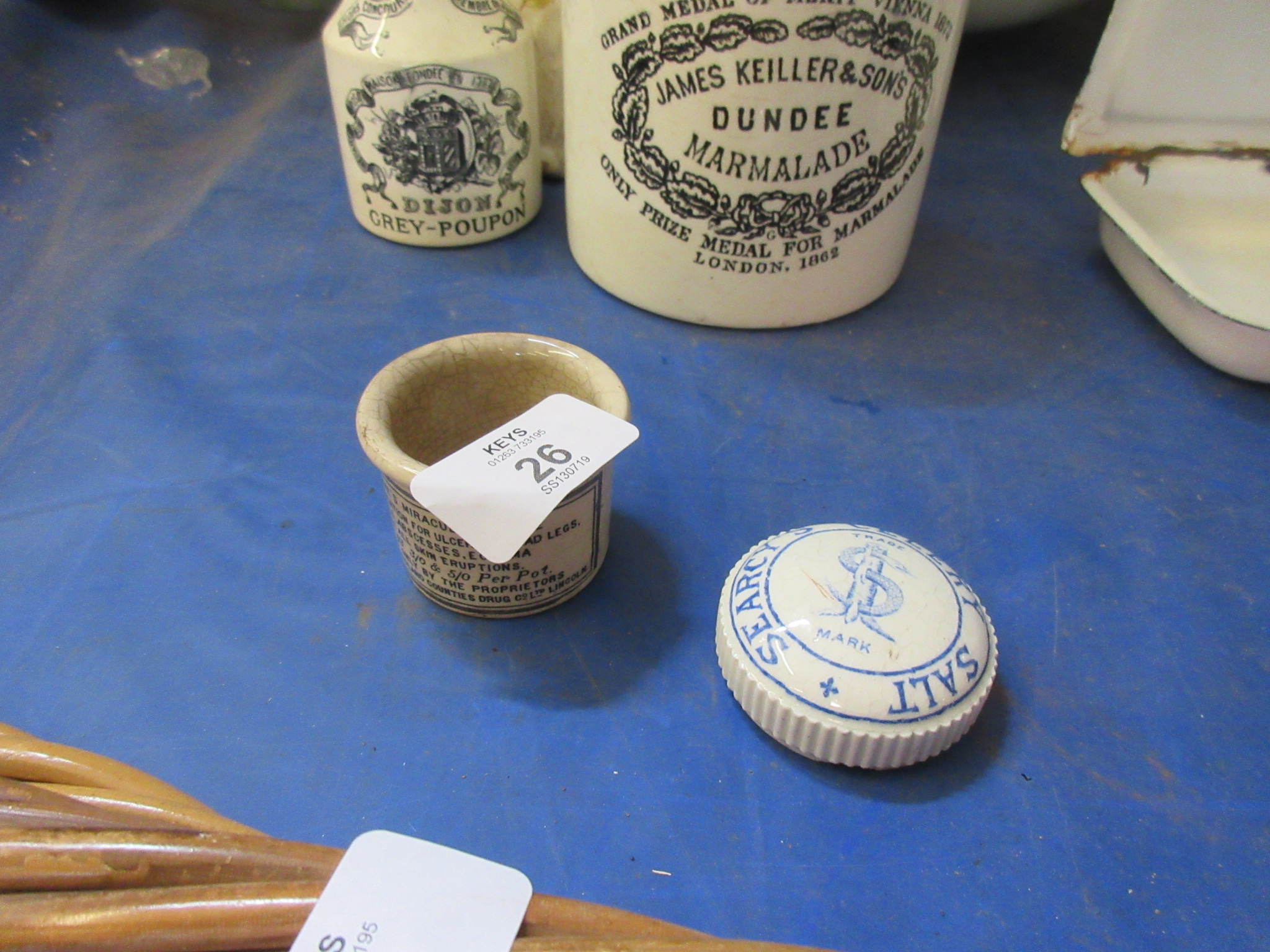 A transfer printed pot for Clarke's miraculous salve, Together with a similar pot lid for Searcy's