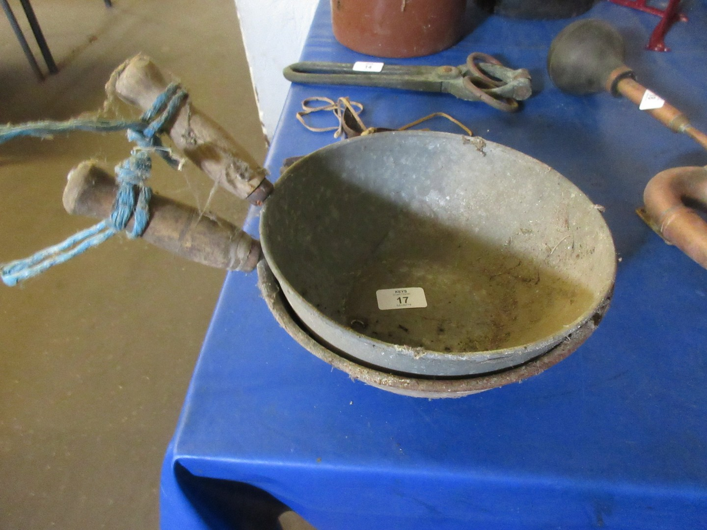 Lot 17 - Two hand cups or feed measures