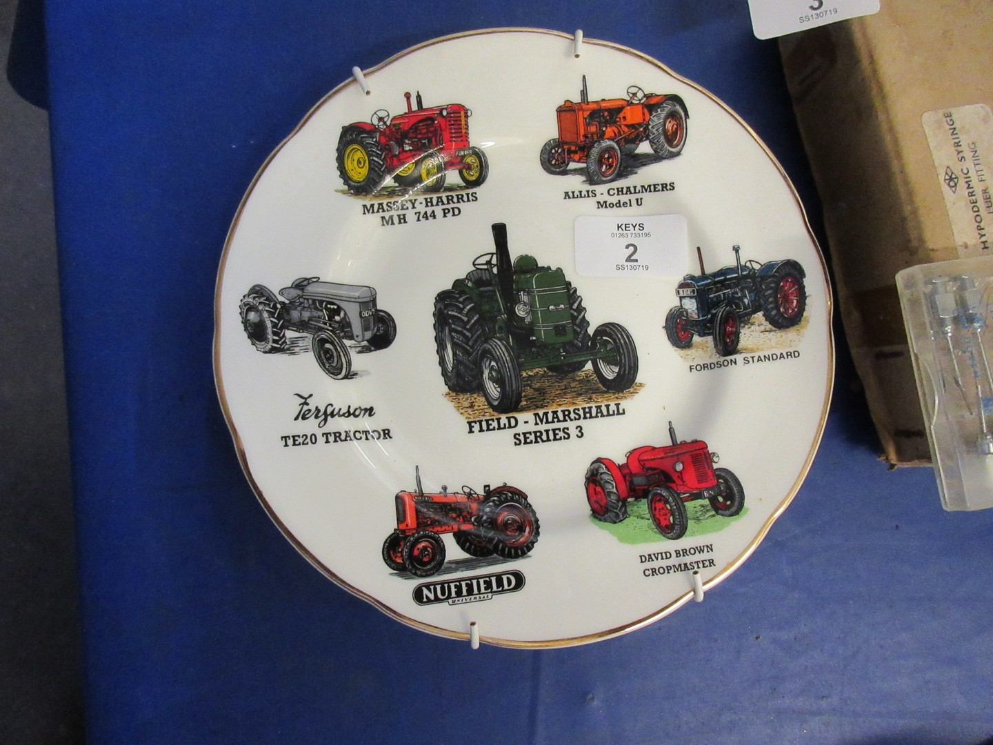 Collectors plate in English fine China featuring various vintage tractors including Massey Harris