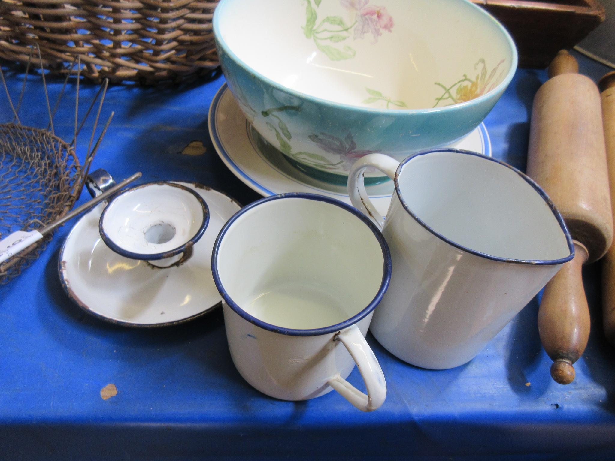 Lot 45 - Three enamelled pieces comprising measuring jug, mug, and candleholder