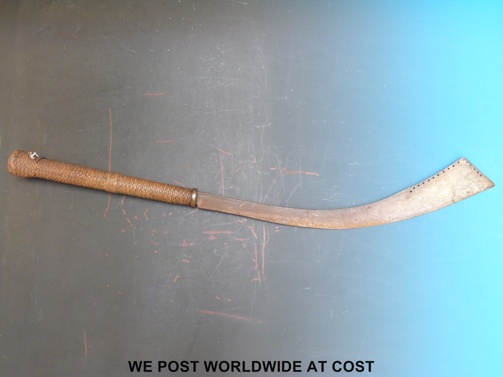 Lot 1565 - A Burmese or Cambodian, East Asian dha type sword with woven cane,
