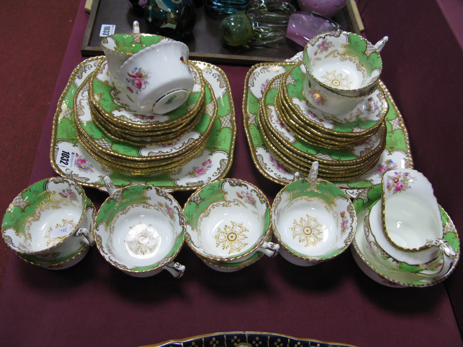 "Lot 1032 - A Coalport Porcelain Part Tea Service, in the green ""Batwing"" pattern, decorated with sprays of"