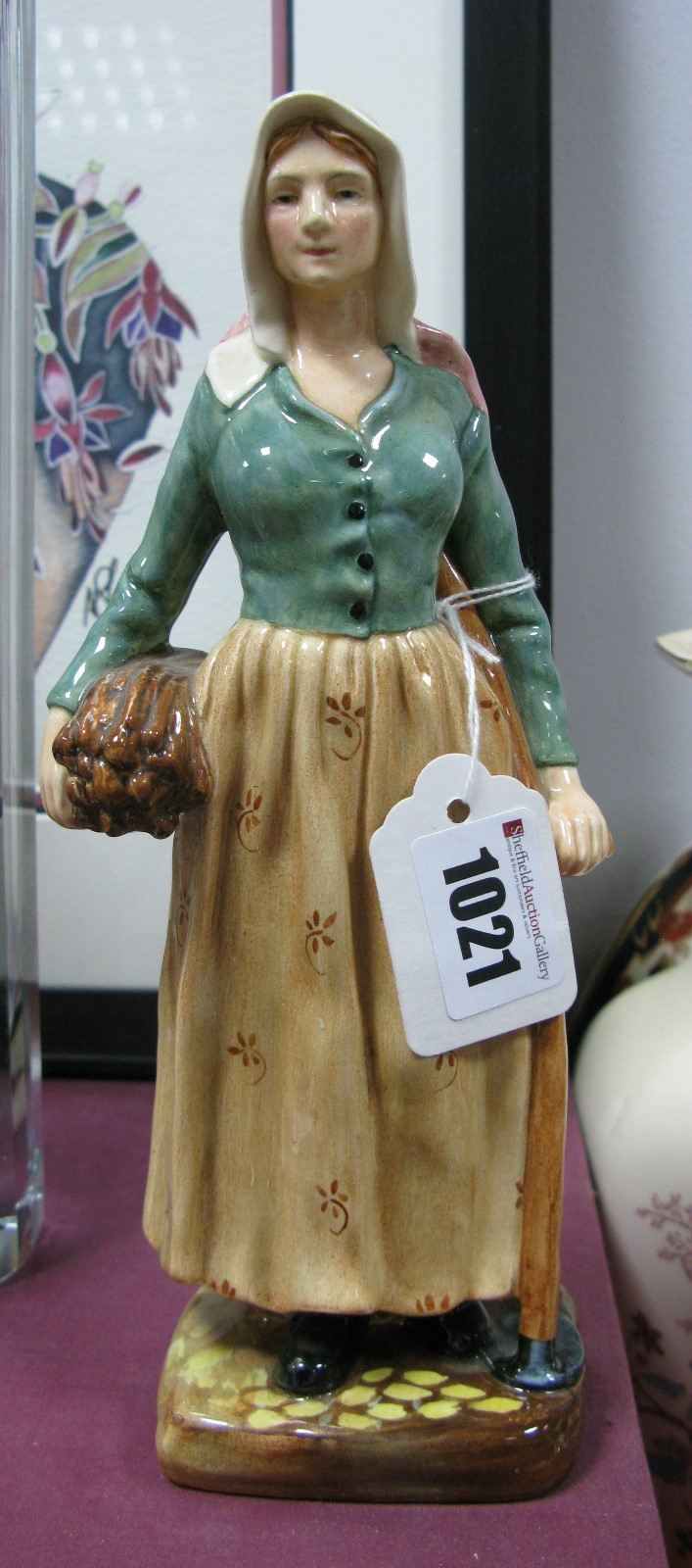 Lot 1021 - A Royal Doulton Figurine 'French Peasant' HN 2075.