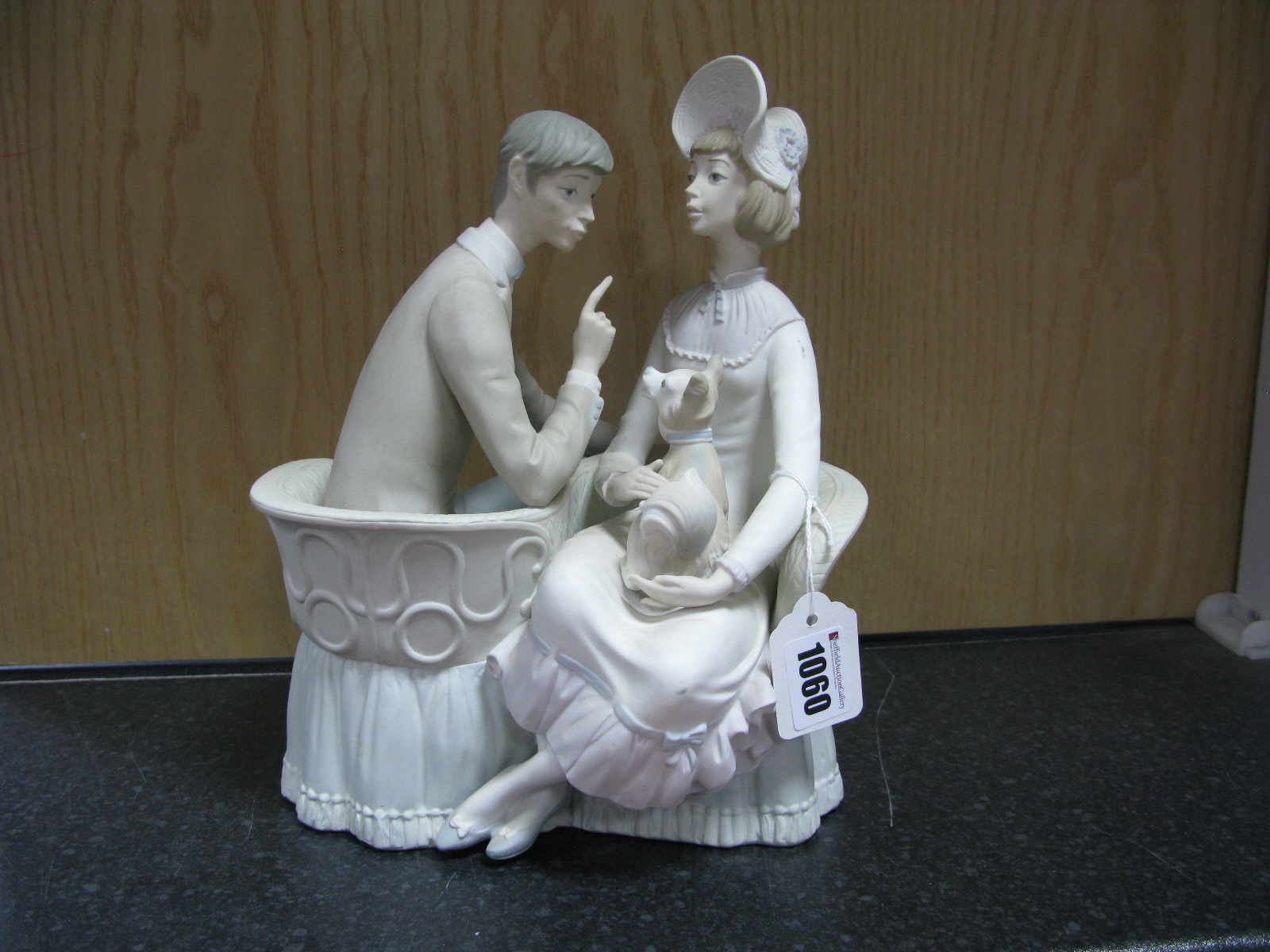 Lot 1060 - Lladro Pottery Figure Group, unglazed, featuring seated courting couple with dog, 26cm high.