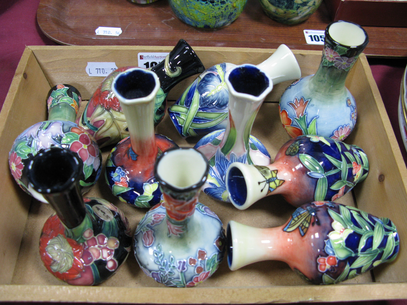 Lot 1057 - Ten Old Tupton Ware Pottery Vases, with varying floral designs, 10cm high.