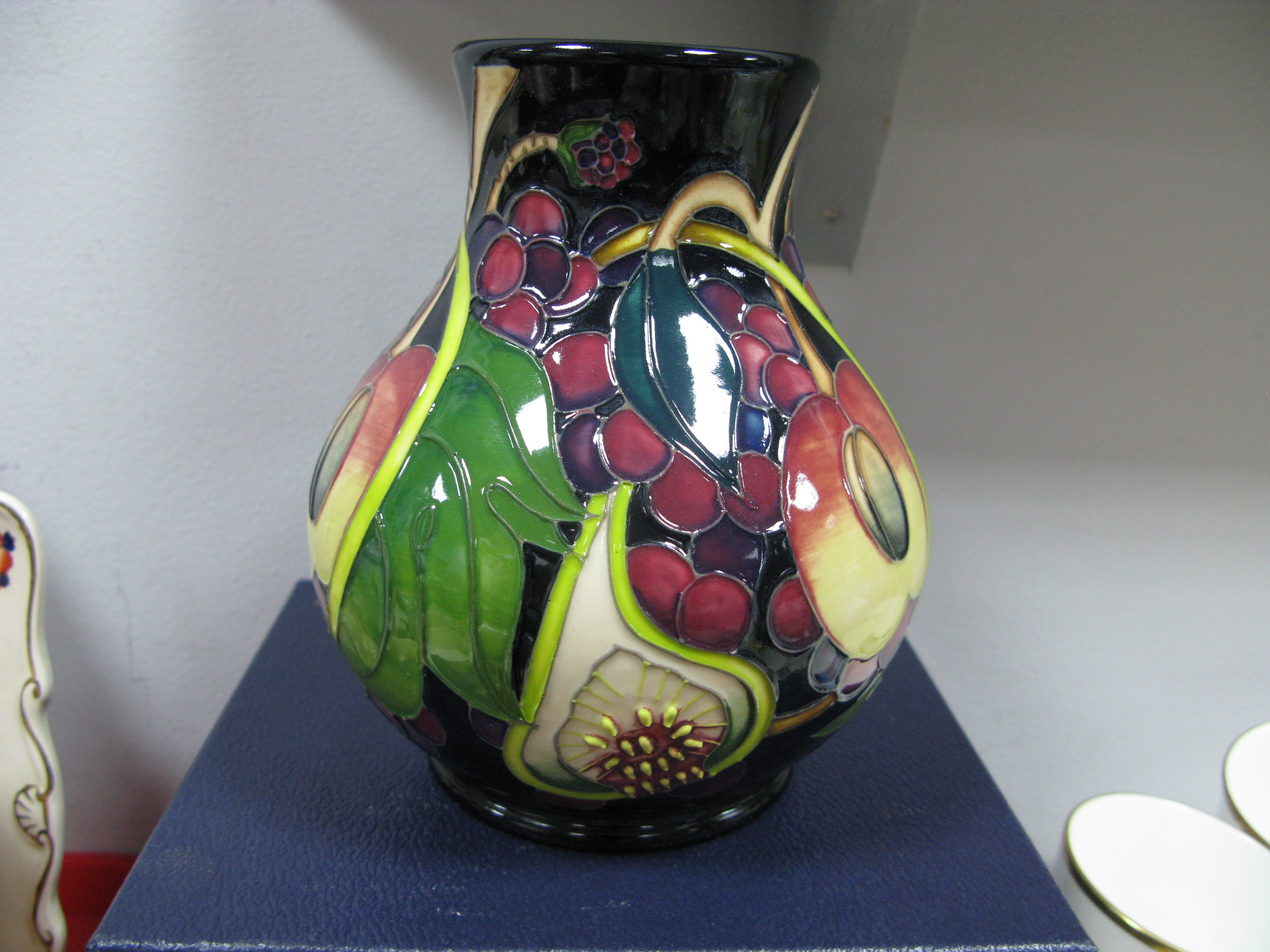 Lot 1017 - A Moorcroft First Quality 'Queens Choice' Vase, shape 869/6, 15cm high.