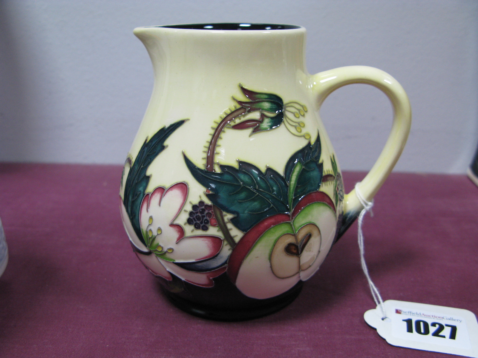 Lot 1027 - A Moorcroft 'Blackberries and Apple' Jug, shape JU2, 'Trial 10.6.16. 11.5cm high.