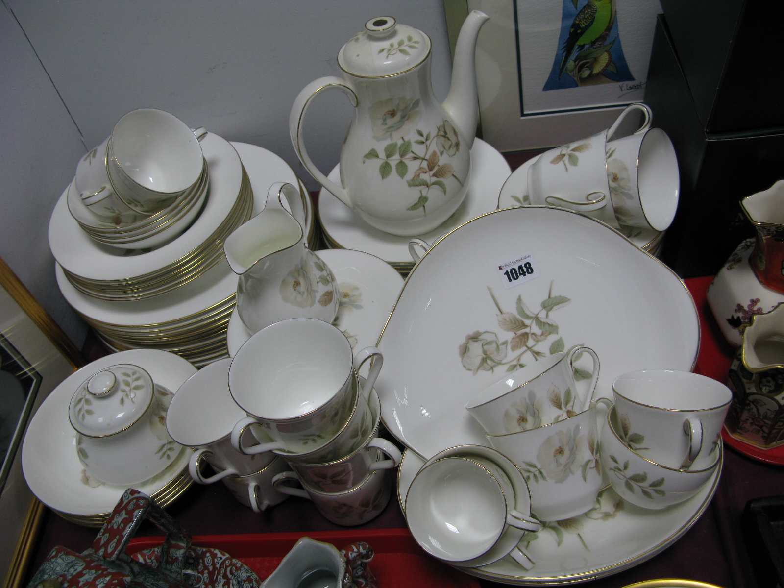 """Lot 1048 - A Royal Doulton """"Yorkshire Rose"""" Pattern Dinner-Tea Service, dinner plates, side plates, bowls, cup,"""