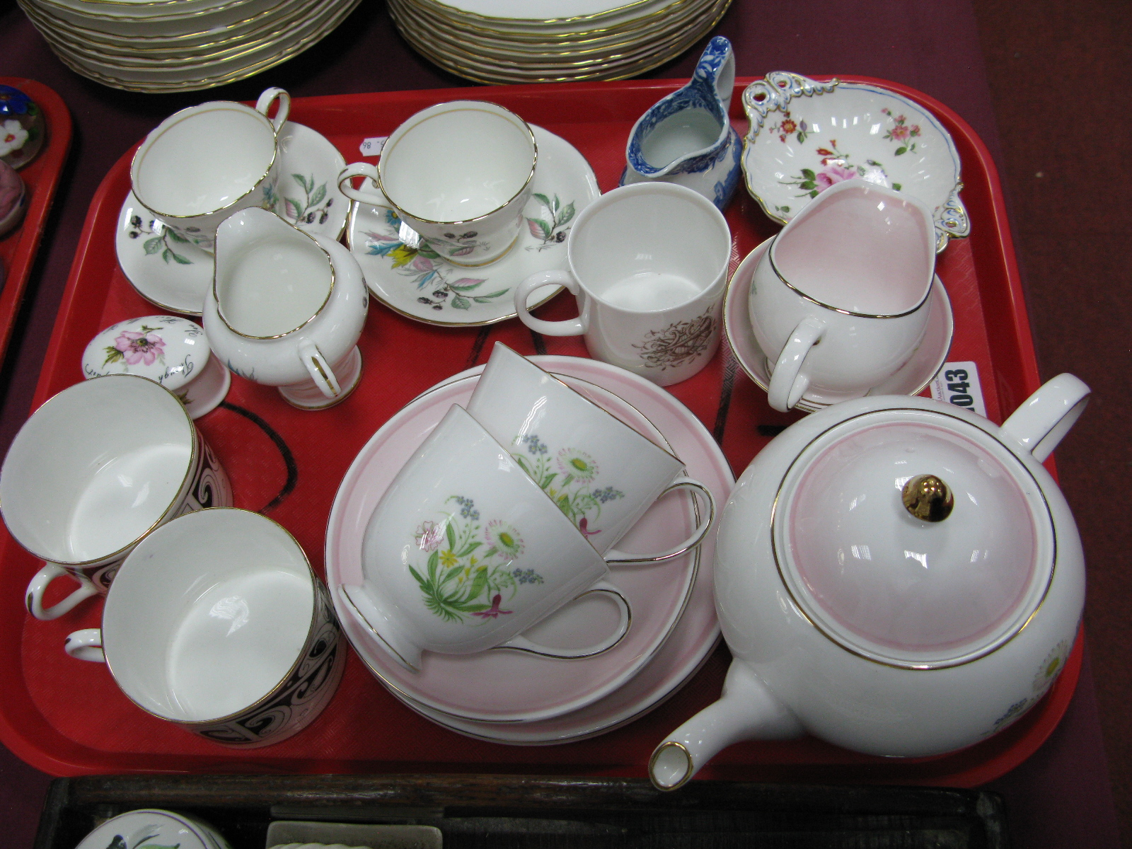 Lot 1043 - A Susie Cooper 'Romance' Pink Tea for Two, Crown Derby pin tray, Doulton Maori Art cups etc:- One