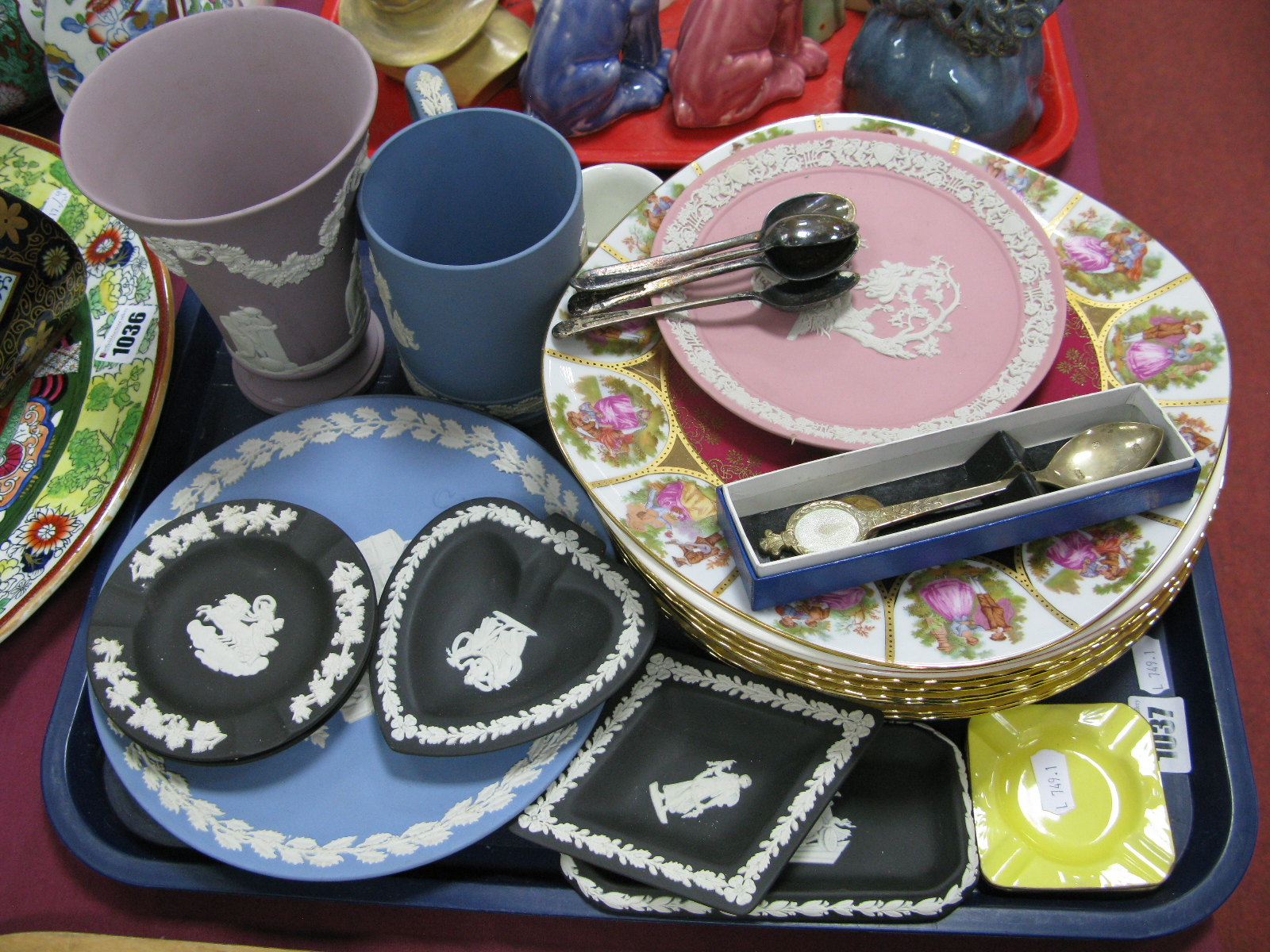 Lot 1037 - Wedgwood Jasperware, cabinet plates, pin dishes, vase, tankard etc in powder pink, blue and black,