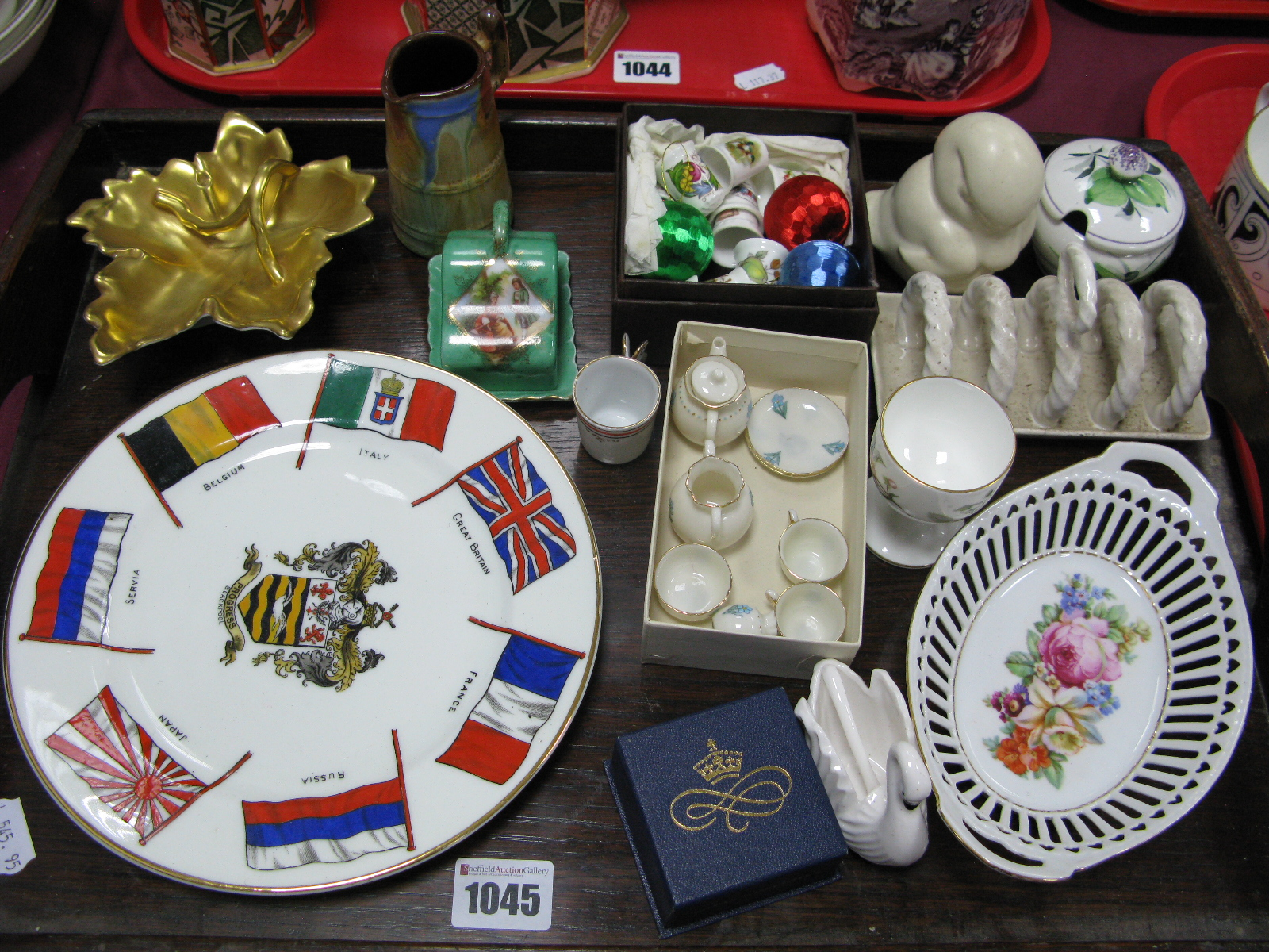 Lot 1045 - A Goss Minature Tea Set, seven Nations plate, thimbles etc:- One Tray