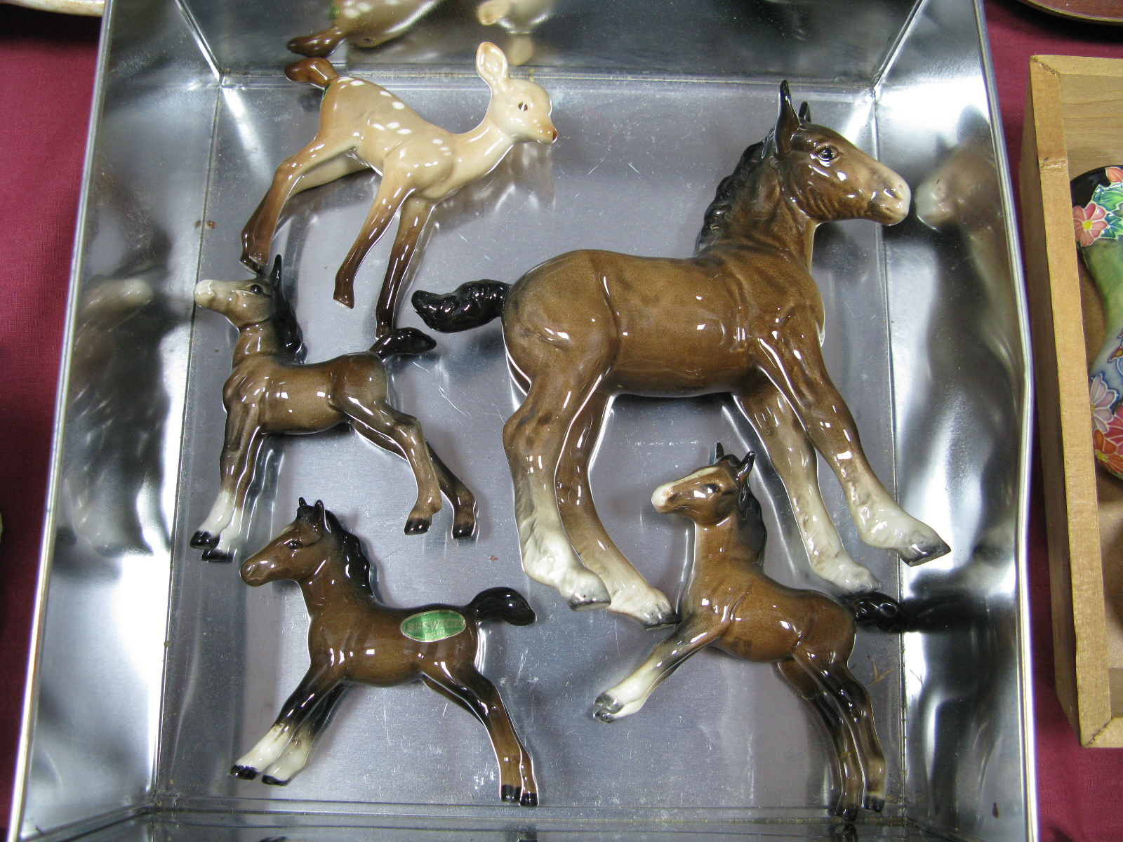 Lot 1059 - A Beswick Pottery Pony Looking To It's Right, 15cm high, three other smaller (one damaged) plus