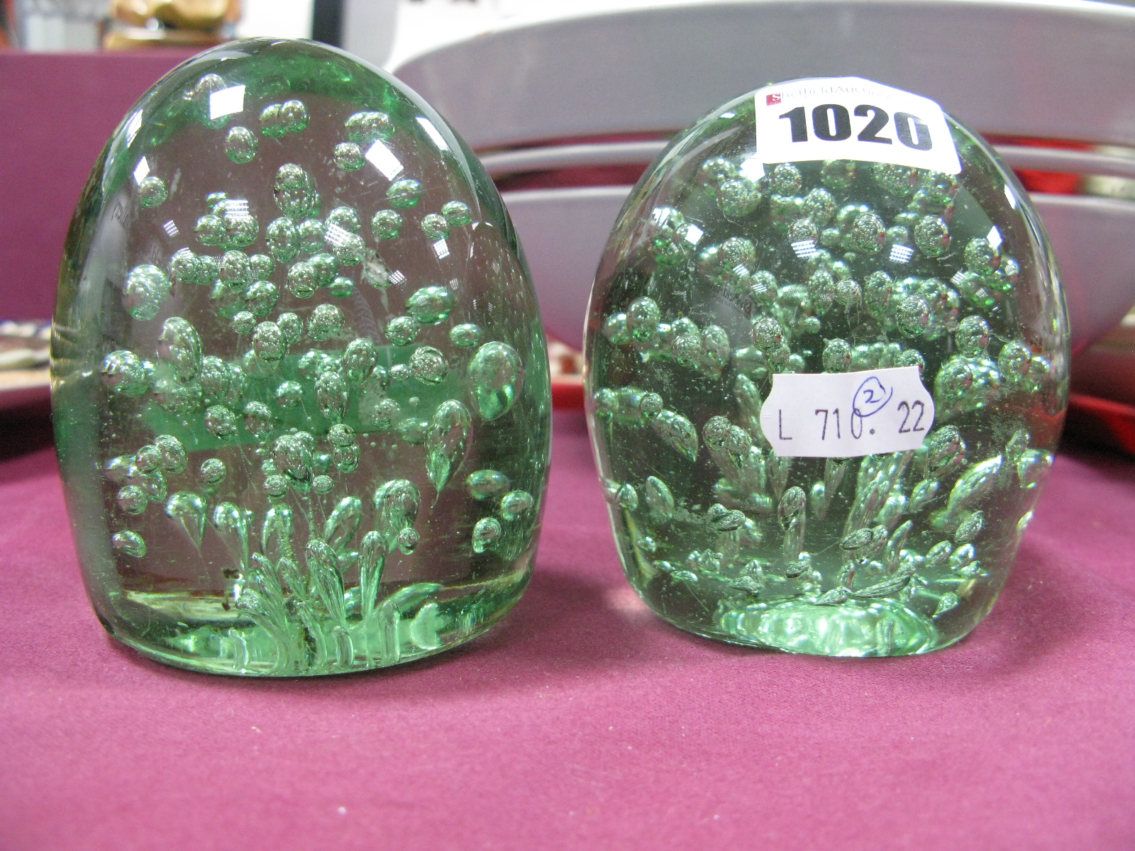 Lot 1020 - Two XIX Century Glass Dumps, with bubble inclusions, 9.5cm high.