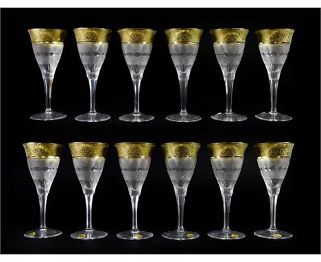 A Set of Twelve Moser Wine Glasses, late 20th century, with etched gilt rims over bands of geometric cutting on panelled stem
