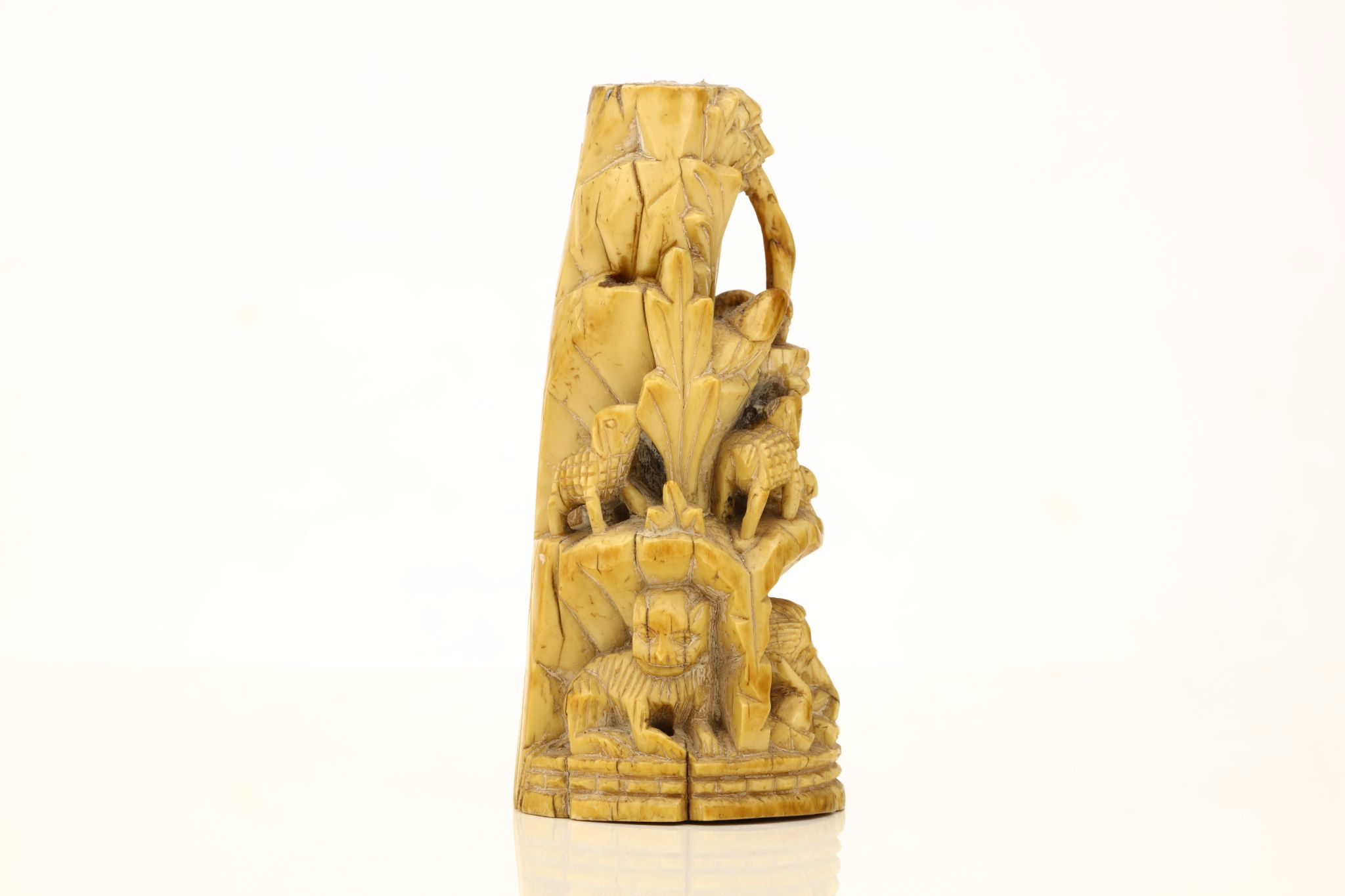 Lot 558 - A CARVED IVORY 'MOUNT OF THE GOOD SHEPHERD' PLINTH. Goa, circa 1650. Carved to depict the fountain