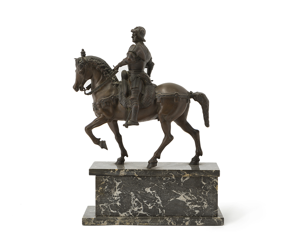 Lot 27 - A patinated bronze horse and rider