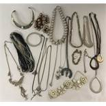 A small collection of vintage and modern costume jewellery.