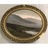 Oval shaped oil on board of a Scottish heathland scene in ornate gilt frame.