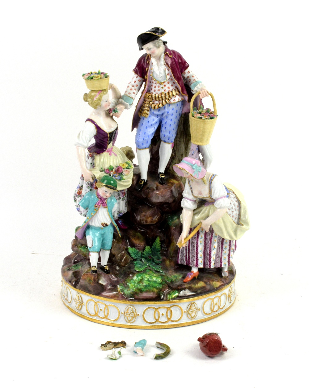 Lot 3038 - Meissen porcelain figural group of man, women and child digging and gathering flowers on a rocky