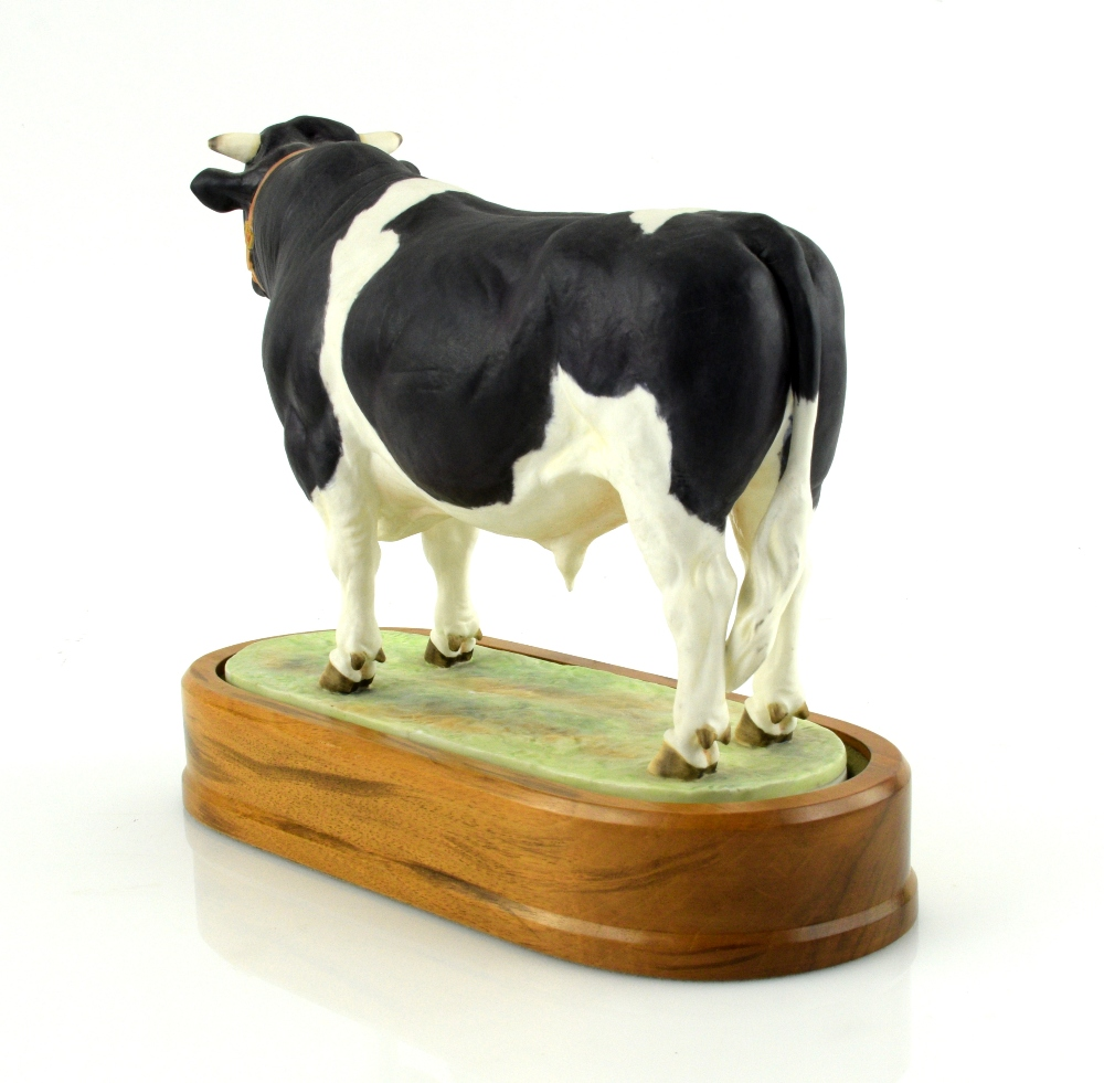 Lot 3011 - Royal Worcester porcelain Friesian Bull modelled by Doris Lindner 1964 with a wooden plinth 16cm x
