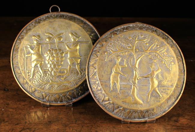 Lot 46 - A Pair of Antique Brass Wall Plaques.