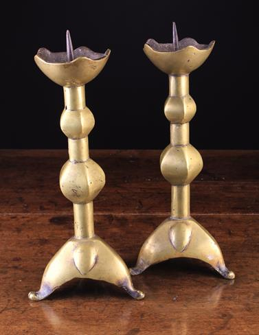 Lot 38 - A Pair of Gothic Brass Pricket Candlesticks.