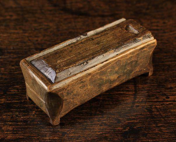 Lot 25 - A Small 18th or 19th Century Dug Out Treen Box of rectangular form on small integral feet with a