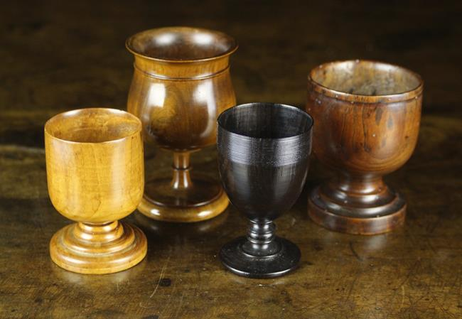 Lot 17 - Four Treen Goblets: A Small Lignum Vitae Goblet of 17th century style with a finely reeded band to