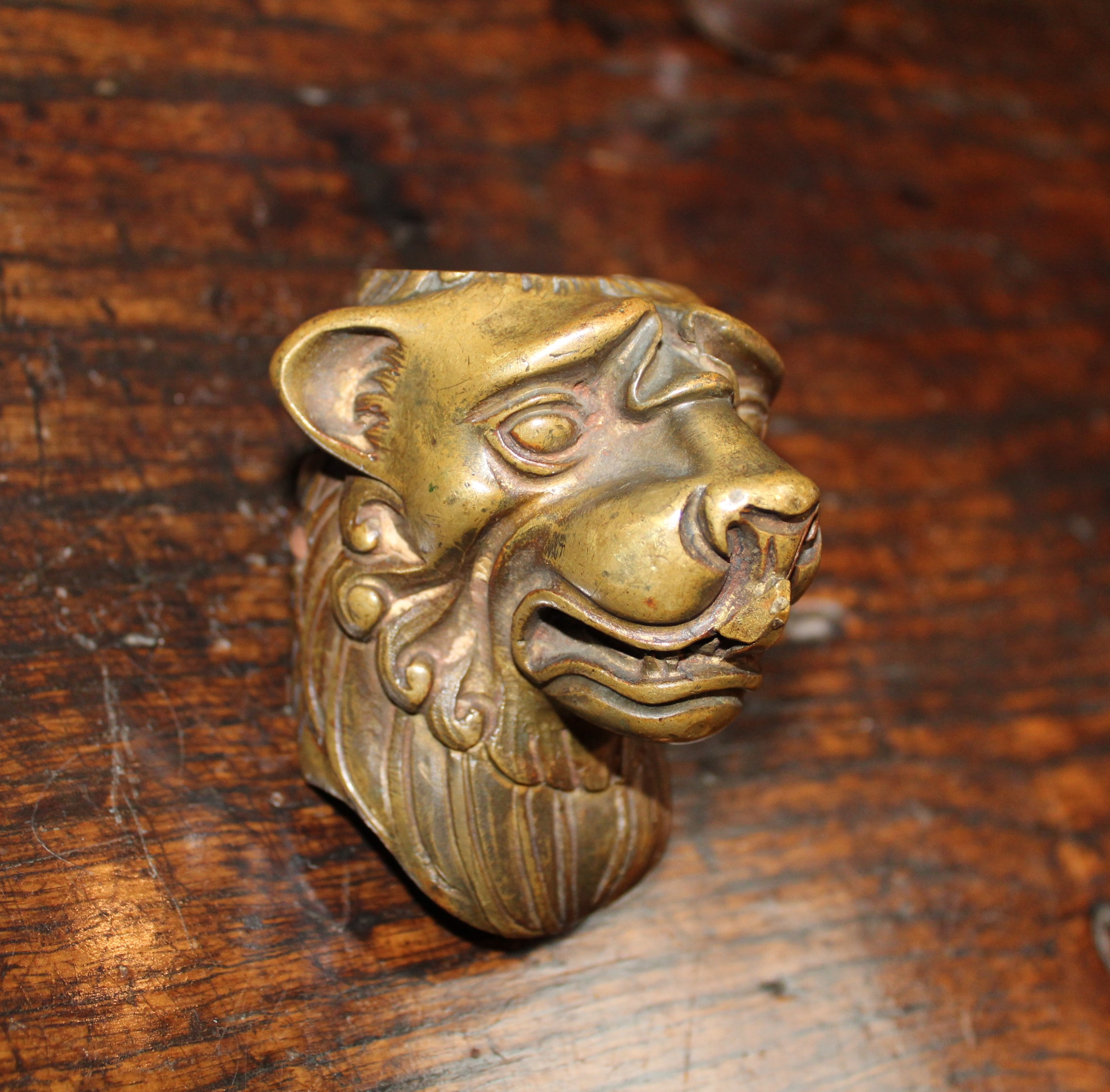 Lot 48A - An Antique Bronze Mount cast as a lion's head, 3¼ in (8.5 cm) high, 2½ in (6.5 cm) wide, 2½ in (6.