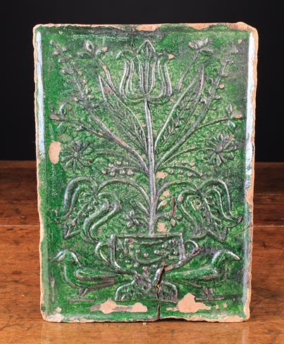 Lot 51 - An 18th Century German or Dutch Green Glazed Terracotta Stove Tile moulded with an urn of tulips