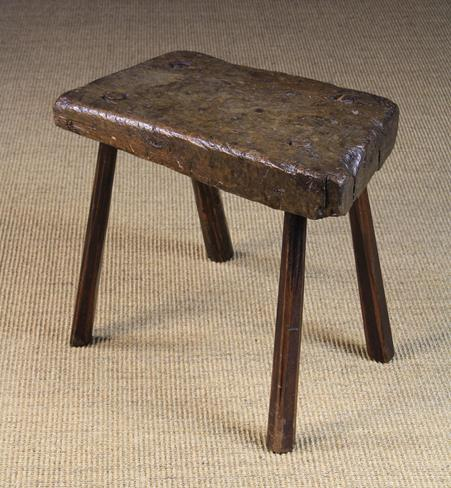 Lot 29 - An Early 19th Century Primitive Stool. The 3 inch (7.