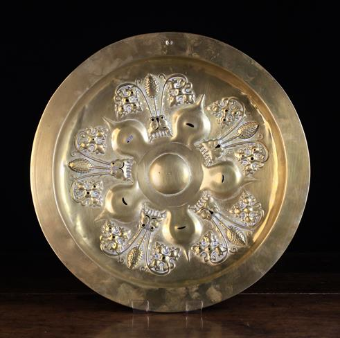 Lot 40 - A 15th Century Dinant Brass Arms Dish. Decorated with flowers and punchwork within a wide border.