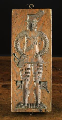 Lot 8 - A Late 17th/Early 18th Century Ginger Bread Mould with a finely dressed gentleman to one side and a