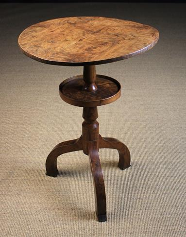 Lot 27 - A Rustic Elm Two Tiered Tripod Table.