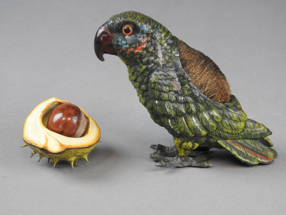 A cold painted metal hollow cast pen wipe,early 20th century, in the form of a parrot,