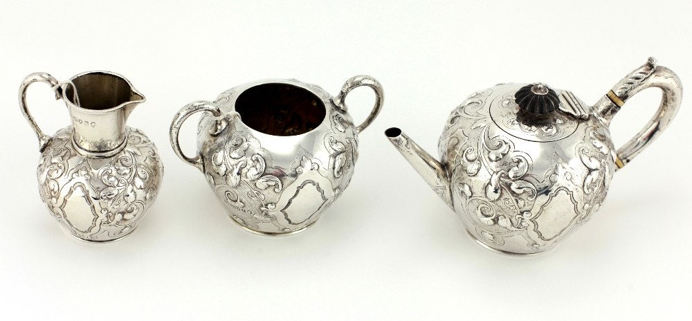 Lot 34 - An attractive Victorian silver Bachelors Tea Service, with repoussé decoration comprising a teapot,