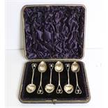 A set of 6 cased Art Deco silver Teaspoons, hall marked c. 1894, in leather case.